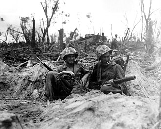 M1919 Browning machine gun - A Marine cradles his M1919 Browning machine gun in his lap in Peleliu