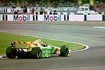 Riccardo Patrese - Benetton B193B at the 1993 British Grand Prix (32873454863).jpg