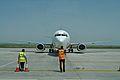 Romania Iași Airport Flagman Directs Pilot (Stop).jpg