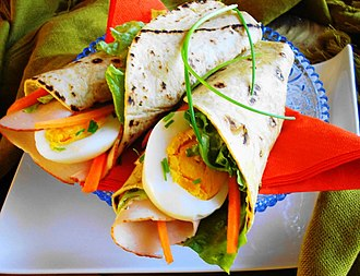 Roti - A roti wrap with boiled egg and smoked chicken in the Netherlands