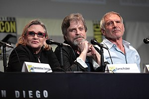 Star Wars -  The main cast members of the original Star Wars trilogy, who reprised their characters in supporting roles on the sequel trilogy; from left: Carrie Fisher, Mark Hamill, and Harrison Ford (SDCC, July 2015).