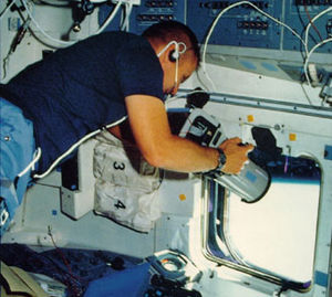 Robert F. Overmyer - Overmyer aiming a camera out of an overhead window of Space Shuttle ''Challenger'' during the STS-51-B mission