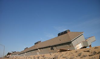 Effects of Hurricane Sandy in New Jersey - The Driftwood Cabana Club alongside NJ 36 in Sea Bright that was toppled due to Sandy