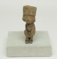 Seated Figurine Holding Smaller Figure.png