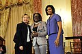 Secretary Clinton With First Lady Michelle Obama and Jestina Mukoko (4425068927).jpg