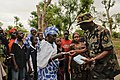 Sgt. Ibrahim Seima, a nurse with the Senegalese Armed Forces, passes out medical charting booklets to patients awaiting treatment outside a clinic in Thies, Senegal, July 12, 2012, during Western Accord 2012 120711-Z-KE462-031.jpg