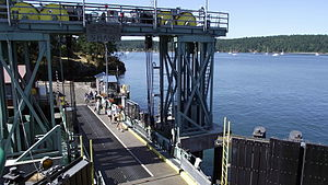 Shaw Island - The ferry dock at Blind Bay. This terminal has a native Orca petroglyph carving sign unlike the other San Juans with the generic island name signs