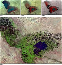Lake Chad in a 2001 satellite image, with the actual lake in blue, and vegetation on top of the old lake bed in green. Above that, the changes from 1973 to 1997 are shown.