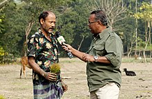 Shykh Seraj interviews a farmer.jpg