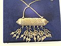Silver amulet with pendants.jpg