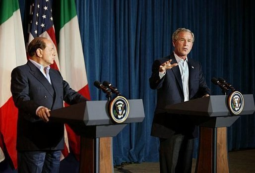 Silvio Berlusconi and George W. Bush, speaking at Crawford, Texas