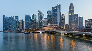 Skyline of the Central Business District of Singapore with Esplanade Bridge in the evening.jpg