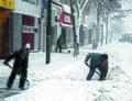Snowshovelling (8098088076).jpg