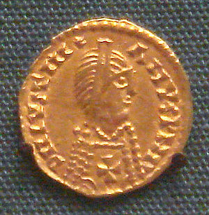 Visigothic Kingdom - Visigothic pseudo-imperial gold tremissis in the name of emperor Justinian I, 6th century: the Christian cross on the breast defines the Visigothic attribution. (British Museum)