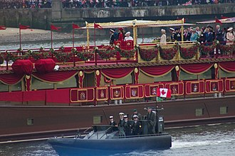 Diamond Jubilee of Elizabeth II - Left to right, atop barge: (grouped at left) the Duke of Edinburgh; the Duke of Cambridge; the Duchess of Cambridge; Prince Harry; Queen Elizabeth II; (grouped at right) the Duchess of Cornwall; the Prince of Wales, aboard the MV Spirit of Chartwell during the Thames Diamond Jubilee Pageant on 3 June 2012