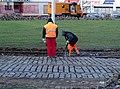 Spořilov, oprava tramvajové smyčky, práce se sbíječkou.jpg