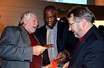 Stadtkulturpreis Hannover 2013 (302) Hans Mönninghoff, Abayomi Bankole und Thomas Hermann mit einem Faltblatt zur nächsten Veranstaltung.jpg