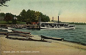 Mountain Division - Steamboat landing at Sebago Lake Station in 1907 (note transfer of freight from boxcar to left of steamboat)