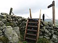 Stile and signpost, summit of Lee Pen - geograph.org.uk - 233275.jpg