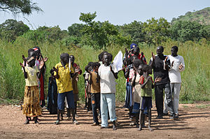 Schoolchildren meet the plane in Boma, where t...