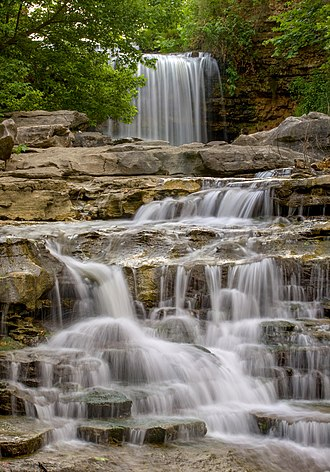 Bella Vista, Arkansas - Tanyard Creek falling from Lake Windsor in Bella Vista