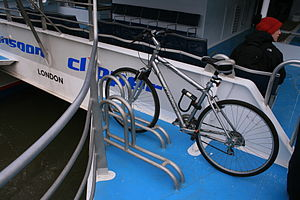 Cycling in London - A bike rack on a Thames Clipper commuter catamaran on the River Thames.