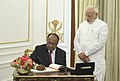 The Prime Minister of the Republic of Vanuatu, Mr. Charlot Salwai signing the visitors' book, at Hyderabad House, in New Delhi on March 09, 2018. The Prime Minister, Shri Narendra Modi is also seen.jpg