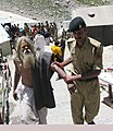 The Security personnel lending a helping hand to the Pilgrims at the Amarnath Shrine Cave.jpg