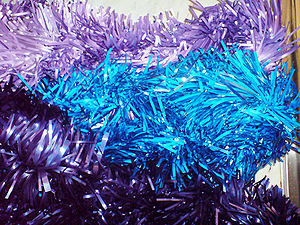 Tinsel - Ornamental strips made of lilac, blue and purple colored tinsel
