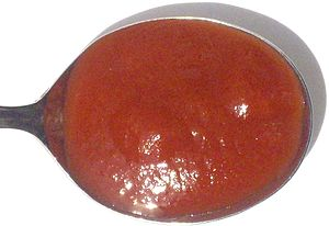 Tomato purée - A spoonful of tomato purée