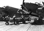 Torpedo is loaded on TBM aboard USS San Jacinto (CVL-30) in October 1944.jpg