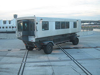 Mobile lounge Bus-like system for boarding and disembarking from aircraft