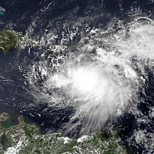 Satellite imagery of a disorganized tropical cyclone in the Caribbean Sea.