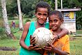 Two boys holding football, Raviravi, Fiji, Summer 2006.jpg