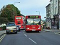 Two buses pass in The Burroughs.jpg