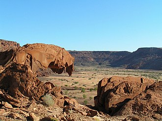 """Twyfelfontein - The """"lion's mouth"""" rock formation throning on top of Huab valley"""
