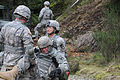 U.S. Army Capt. Molly Byrnes, right, a staff officer with the 56th Multifunction Medical Battalion, extricates a mock casualty from a vehicle that was disabled by a simulated improvised explosive devise during 130409-A-FF538-104.jpg
