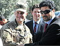U.S. Army Capt. Nate Wylie, left, an operations officer for a Kabul-based civil-military support team with U.S. Forces- Afghanistan (USFOR-A), receives an Olympic pin from Lt. Gen. Muhammad Zahir Akhbar 111016-A-JR210-687.jpg