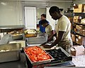 U.S. Army Spc. Ciara Johnson, foreground, assigned to Headquarters Platoon, Echo Company, 2nd Battalion, 4th Infantry Regiment, 4th Brigade Combat Team, 10th Mountain Division, helps prepare dinner at Forward 130819-A-NH795-004.jpg
