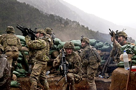 U.S. Army infantrymen from 3rd Platoon, Charlie Company, 2/327th Infantry Regiment in a firefight with Taliban guerrillas, Kunar Province, Afghanistan during Operation Strong Eagle III (31 March 2011) U.S. Army firefight in Kunar.jpg