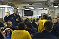 U.S. Navy Capt. Daniel B. Uhls, standing left, the commanding officer of the guided missile cruiser USS Hue City (CG 66), speaks to Sailors during an all-hands call in the U.S. 5th Fleet area of responsibility 130525-N-ER662-130.jpg
