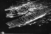 USS Leyte (CV-32) and USS Henderson (DD-785) refueling from an oiler off Korea, circa in 1950