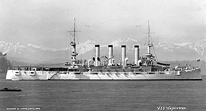 USS Washington (ACR-11) off Seattle, Washington, with the Olympic Mountains in the distance, 1908.
