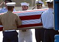 US Navy 020927-N-3228G-002 A Sailor assists joint-service coffin bearers with one of eight sets of remains recovered in North Korea during a repatriation ceremony.jpg