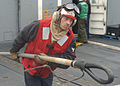 US Navy 030224-N-6141B-083 Hull Technician 3rd Class Ricky Bohnke carries an MK-105 hoisting-sling.jpg