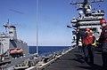 US Navy 030326-N-4308O-004 Gunner's Mates fire the messenger line from USS Harry S. Truman (CVN 75) across to the Military Sealift Command ship USNS John Lenthall (T-AO 189).jpg