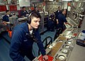US Navy 030625-N-2819P-022 Machinist's Mate 3rd Class Christopher J. Rodrigue from Valentine, La., receives messages from the bridge.jpg