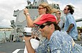 US Navy 030630-N-3228G-002 Actor Rob Lowe, and wife Sheryl Berkoff take photos during a tour of the guided missile destroyer USS Russell (DDG 59).jpg