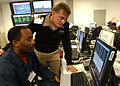 US Navy 040124-N-6027E-001 Mr. William Washington, left, shows Cdr. Jeff Wolstenholme the features of Joint Conflict and Tactical Simulation.jpg
