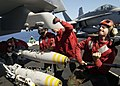 US Navy 040907-N-9293K-031 Aviation Ordnancemen load a 500lb. Mk-82 general purpose bomb on an F-A-18E Super Hornet aboard the Nimitz-class aircraft carrier USS Abraham Lincoln (CVN 72).jpg
